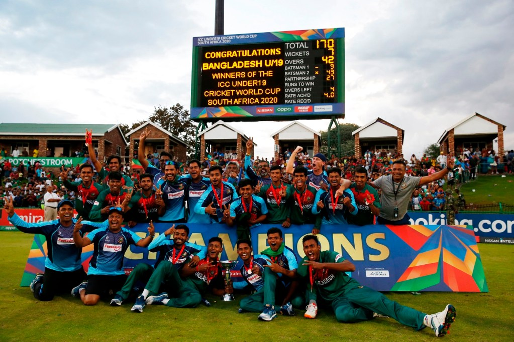 The Bangladesh cricket team pose for a group photograph after winning the ICC Under-19 World Cup cricket finals between India and Bangladesh at the Senwes Park, in Potchefstroom, on February 9, 2020. (Photo by MICHELE SPATARI / AFP) (Photo by MICHELE SPATARI/AFP via Getty Images)