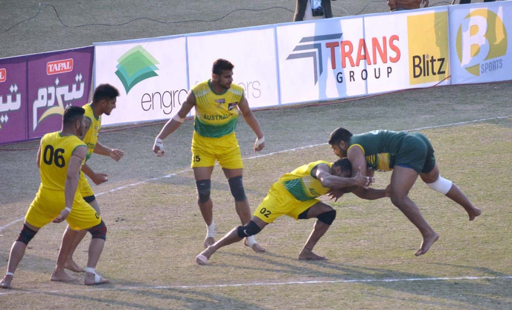 APP55-13 FAISALABAD: February 13 - Players in action during Kabaddi match between Pakistan and Australia teams during Kabaddi World Cup 2020 at Iqbal Stadium. APP photo by Tasawar Abbas