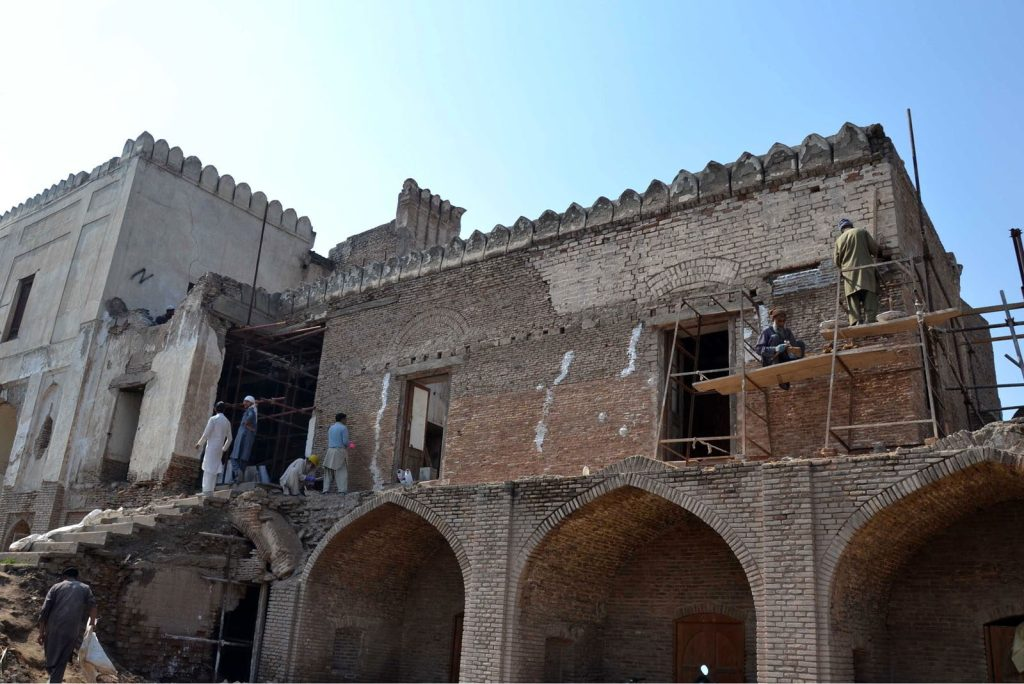 PESHAWAR Workers busy in renovation work of historical Gor Ghatri site. — Photo by Ghulam Murtaza