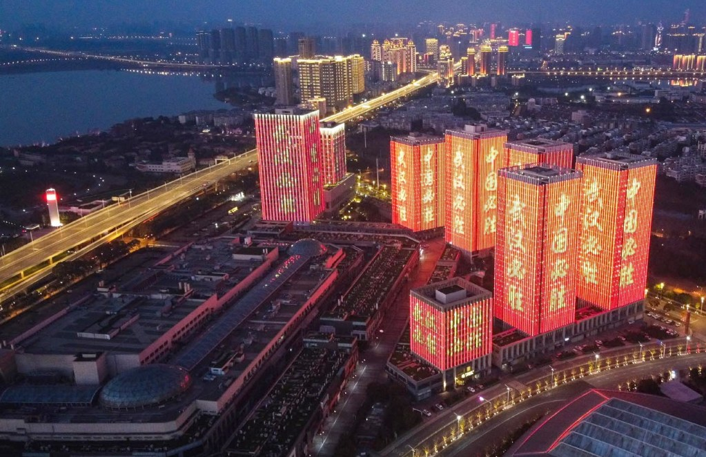 "WUHAN (China): Aerial view of buildings illuminated with cheer-up slogans reading ""Wuhan can win the battle"" ""China can win the battle"" in Wuhan, central China's Hubei Province... Xinhua/ INP PHOTO"