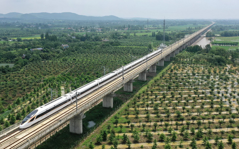 HANGZHOU (China): Aerial photo taken on June 28, 2020 shows a bullet train running on the Shangqiu-Hefei-Hangzhou high-speed railway in Anji County, east China's Zhejiang Province.  A new high-speed railway route connecting east and central China started operation on Sunday.   With a designed speed of 350 kph, the route connects the city of Shangqiu in central China's Henan Province, and Hefei and Hangzhou, the capital cities of east China's Anhui and Zhejiang provinces.. Xinhua/ INP PHOTO