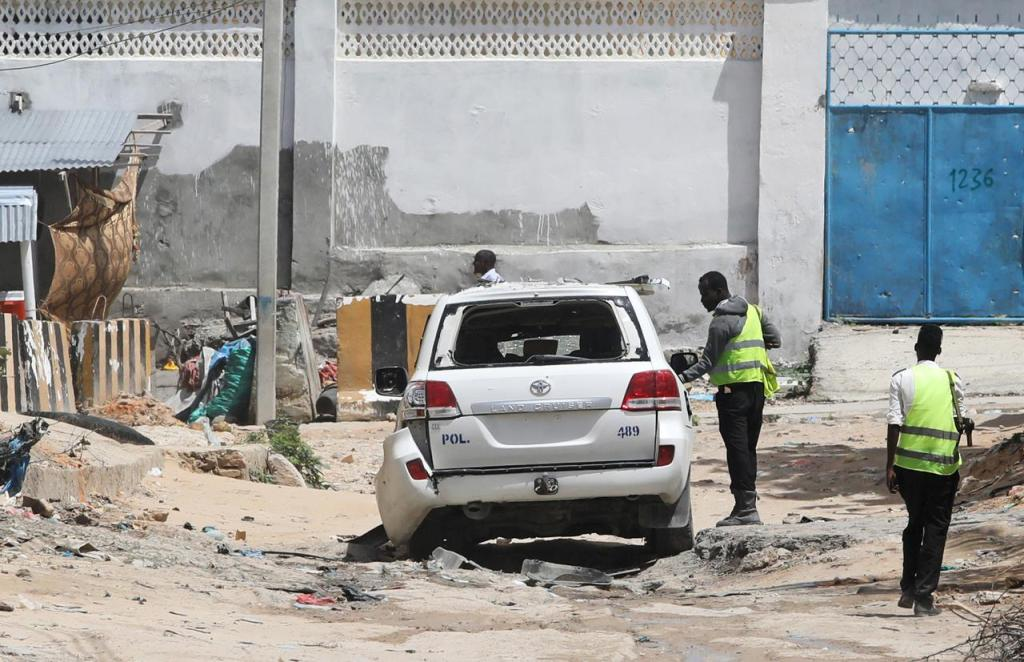 MOGADISHU Somali Police officers standing at the scene after roadside bomb destroyed by a roadside bomb in Hodan district of Somalia.