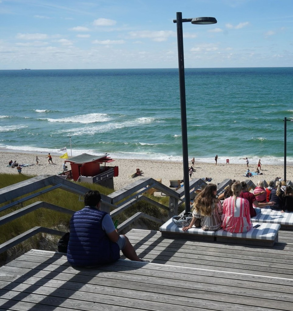 03 August 2020, Sylt, Wenningstedt-Braderup: Numerous holidaymakers enjoy the summer day on the new stairs to the beach. The weather is expected to continue to be good in the coming days. Photo: Jörg Carstensen/dpa (Photo by Jörg Carstensen/picture alliance via Getty Images)