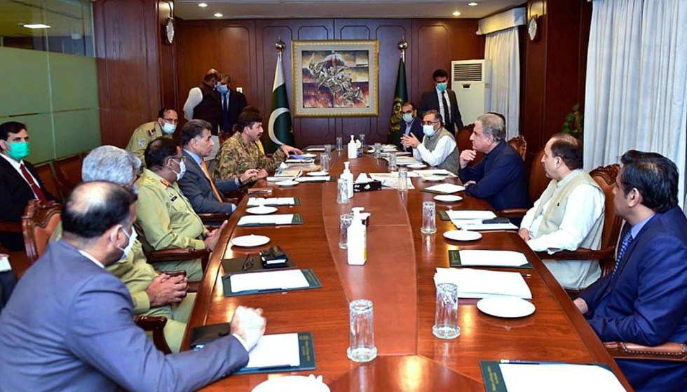 APP25-04 ISLAMABAD: August 04 - Foreign Minister Makhdoom Shah Mahmood Qureshi chairing a high-level meeting regarding 5th August arrangements at Ministry of Foreign Affairs. APP