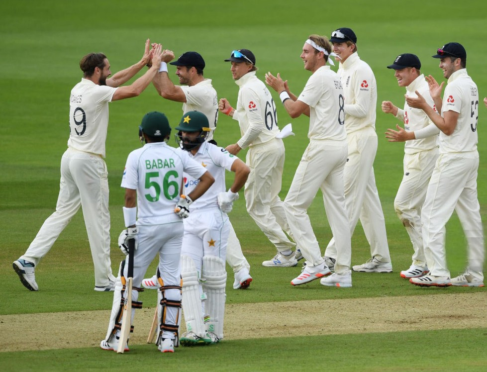 SOUTHAMPTON, ENGLAND - AUGUST 13: Chris Woakes of England celebrates with teammates after the successful review to dismiss Fawad Alam of Pakistan  during Day One of the 2nd #RaiseTheBat Test Match between England and Pakistan at The Ageas Bowl on August 13, 2020 in Southampton, England. (Photo by Gareth Copley/Getty Images for ECB)