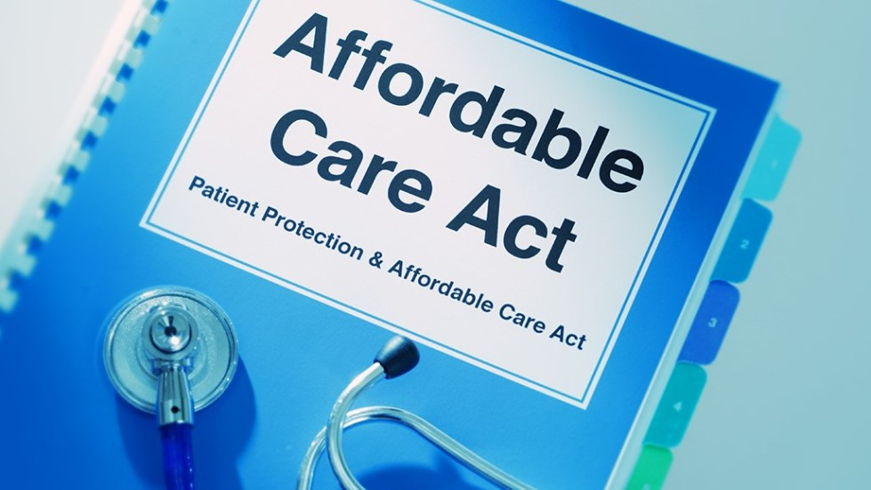 Concept still life of the U.S. Patient Protection and Affordable Care Act. The struggle to provide affordable healthcare to the public. Close-up of a medical stethoscope laying on top of a Affordable Care Act Manual Book.
