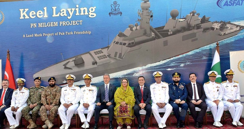 APP12-25 KARACHI: October 25 - A group photo of Minister of National Defence of the Republic of Turkey, HulusiAkar, Chief of the Naval Staff, Admiral Muhammad Amjad Khan Niazi NI(M), Minister for Defence Production Zobaida Jalal, MD KS&EW, Rear Admiral Ather Saleem HI(M) and officers of the project at Keel Laying of MILGEM Class Corvettes. APP Photo M. Saeed Qureshi