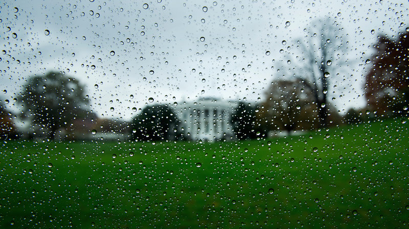 A view of the White House during rain from a motorcade is seen on November 11, 2020, in Washington, DC. - US President Donald Trump and President-elect Joe Biden attended separate, simultaneous ceremonies marking Veterans Day Wednesday, as what should have been a moment of national unity was marred by the Republican's refusal to acknowledge Biden's election win. On a rainy, gray day in Washington the president visited Arlington National Cemetery for a somber wreath-laying ceremony shortly before 11:30 am, his first official appearance since the November 3 election. He made no public remarks. At the same time Biden appeared at the Korean War Memorial in Philadelphia for his own solemn wreath-laying ceremony. (Photo by Brendan Smialowski / AFP) (Photo by BRENDAN SMIALOWSKI/AFP via Getty Images)