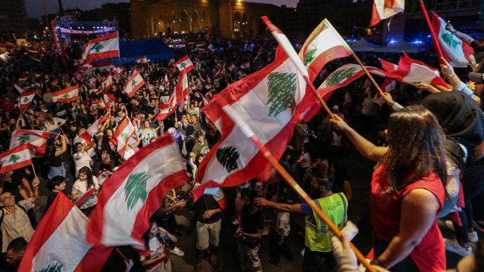 Mandatory Credit: Photo by NABIL MOUNZER/EPA-EFE/Shutterstock (10457855c)Protesters carry placards, wave Lebanese flags, and shout anti-government slogans during a protest in martyr square in downtown Beirut, Lebanon, 27 October 2019. Thousands continued to protest on the second week of demonstrations against proposals of tax hikes and state corruption, and calling for the resignation of the government.Protests in Lebanon, Beirut - 27 Oct 2019