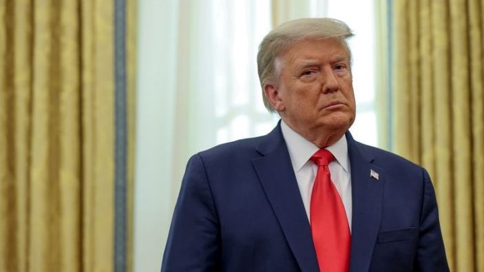FILE PHOTO: U.S. President Donald Trump participates in a medal ceremony in the Oval Office at the White House in Washington, U.S. December 3, 2020. REUTERS/Jonathan Ernst/File Photo