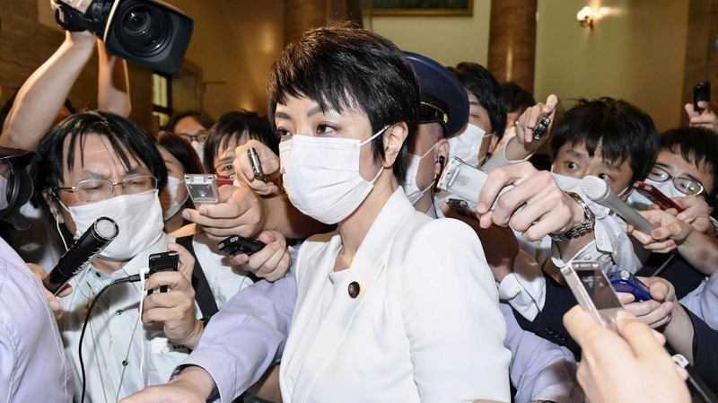 FILE PHOTO: Japan's upper house lawmaker Anri Kawai, the wife of former Japanese Justice Minister Katsuyuki Kawai, is surrounded by reporters after an upper house plenary session in Tokyo, Japan, June 17, 2020, in this picture taken by Kyodo on June 17, 2020. Mandatory credit Kyodo/via REUTERS