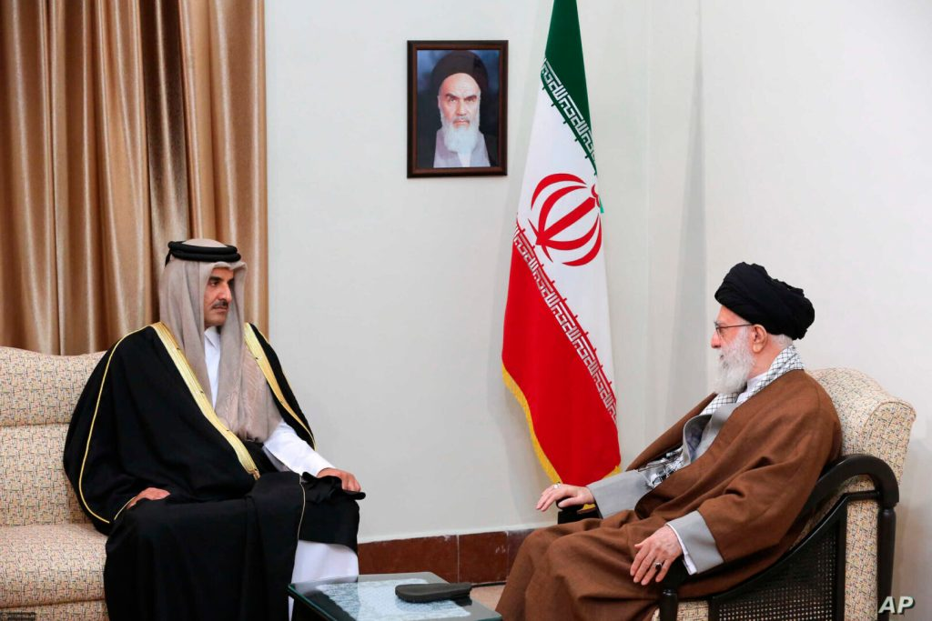 In this photo released by an official website of the office of the Iranian supreme leader, Supreme Leader Ayatollah Ali Khamenei, right, meets Emir of Qatar Sheikh Tamim bin Hamad Al Thani at his office in Tehran, Iran, Sunday, Jan. 12, 2020. (Office of the Iranian Supreme Leader via AP)