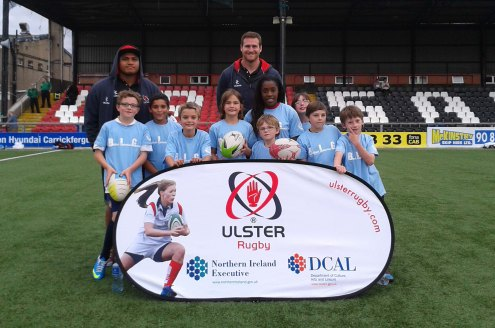 East Belfast: Kids from East Belfast are pictured with Ulster Rugby stars Nick Williams (back left) and Neil McComb (back centre) at the Belfast Interface Games Flagship event at Seaview on Friday evening