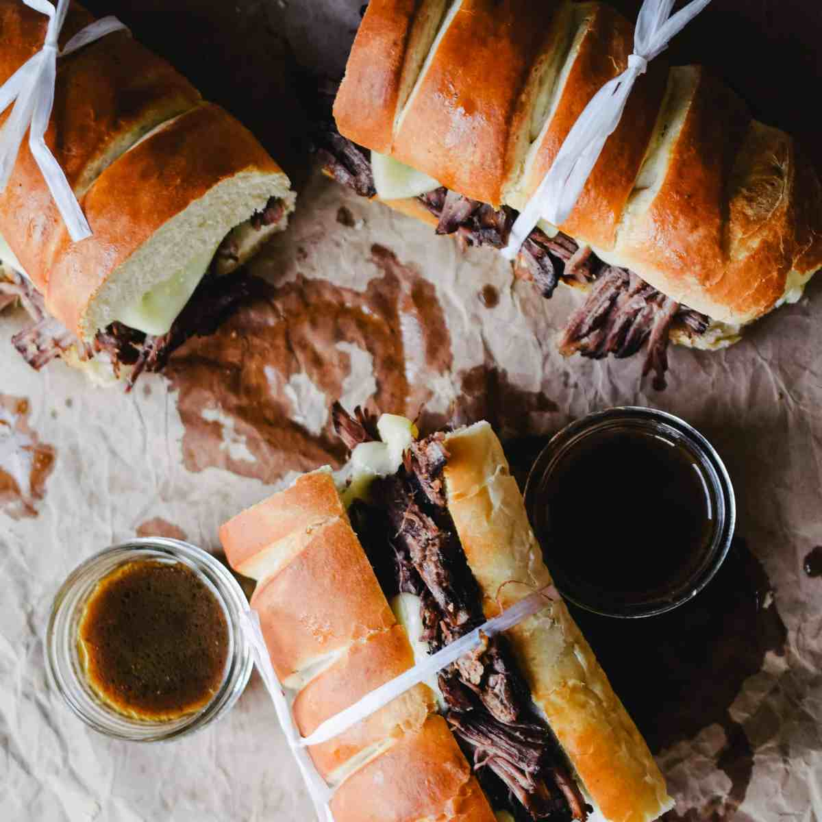 Red Wine Braised Beef French Dip Sandwiches With Au Jus