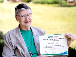 "Sister Dolores Lytle and certificate recognizing her completion of the ""Laudato Si' Animator"" course."