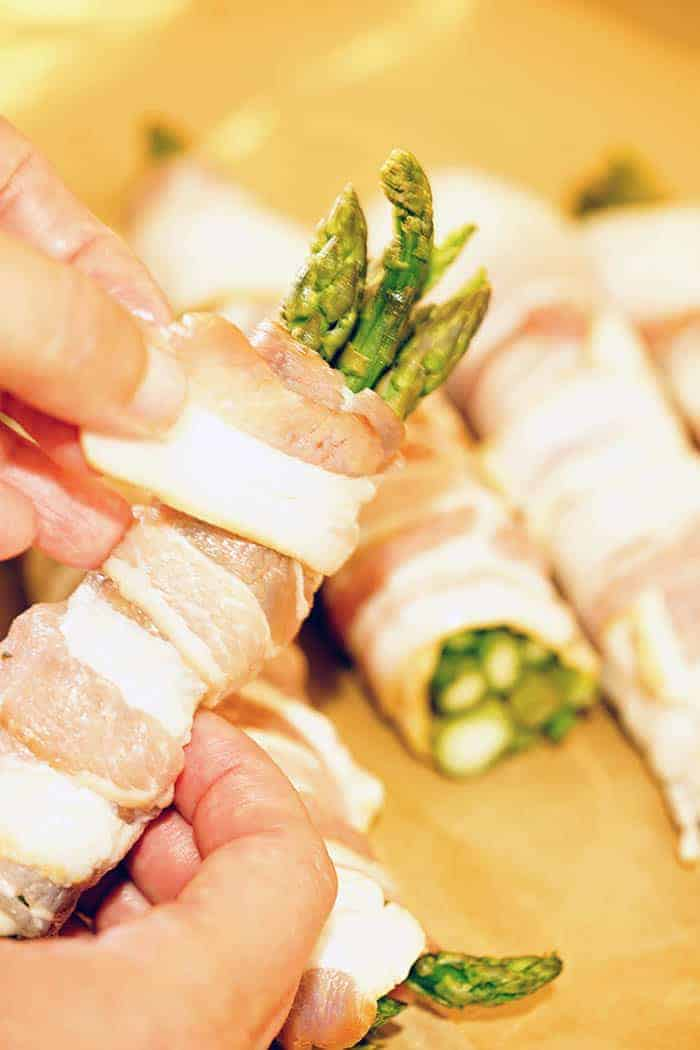 Bundles of asparagus wrapped in bacon