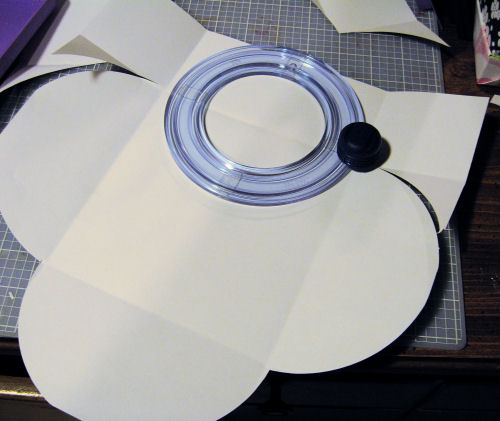 Use a circle cutter to make your flaps.