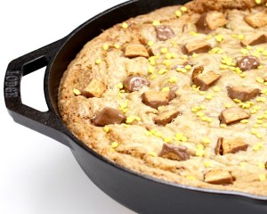 Easy Butterfinger Skillet Cookie Recipe at TheFrugalGirls.com