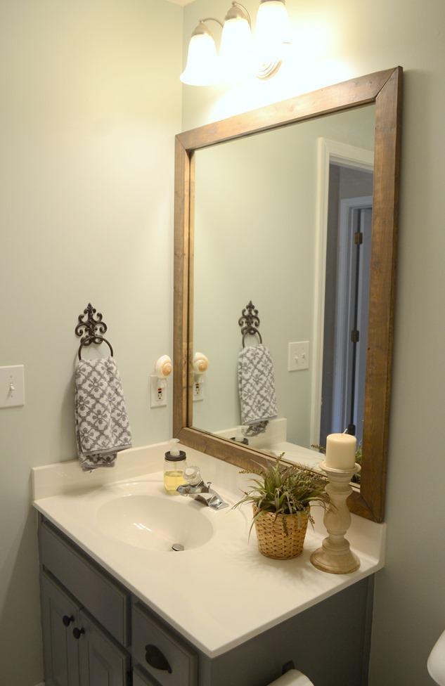 Guest bathroom update  Stained wood framed bathroom mirror