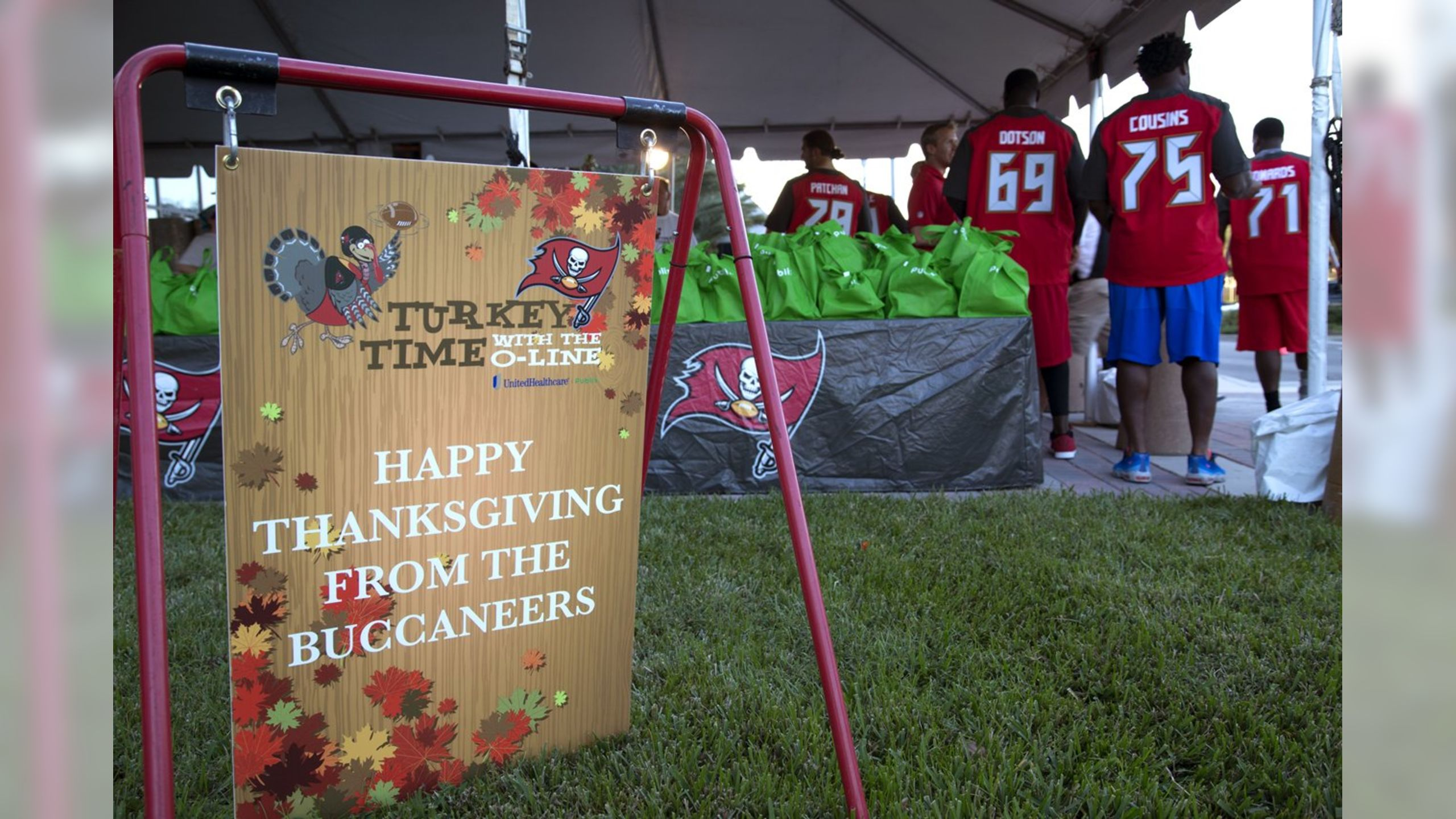 The Tampa Bay Buccaneers O-Line provides Thanksgiving meals to local families