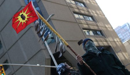A man stands on the street at the rally of solidarity with the Wet'suwet'ens in Febuary. Photo: Aaron Hemens/Fulcrum