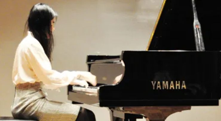 U of O student playing the piano