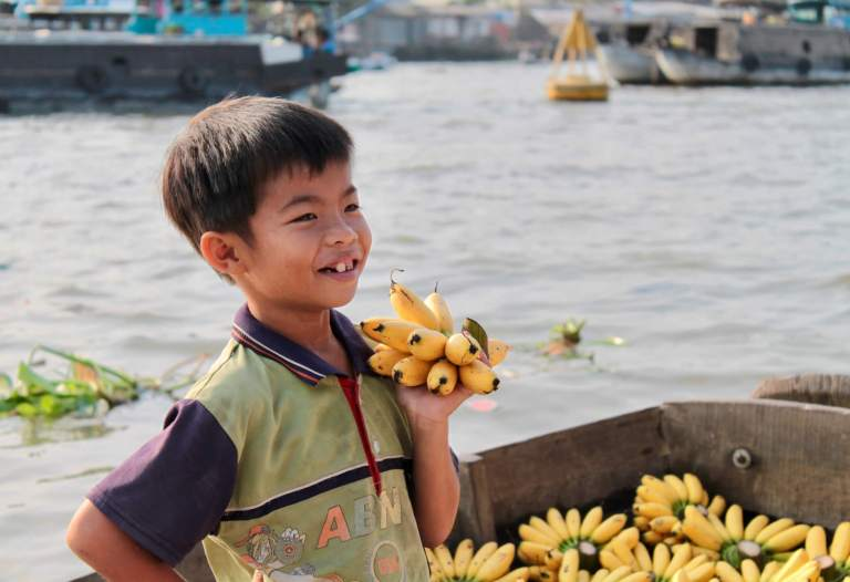Little boy selling bananas