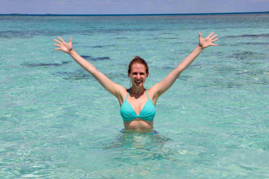 Gwen on the Sandbar. Don't forget to add a bathing suit to your packing list for Belize.