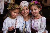 Moldovan grandmother and granddaughters in traditional dress