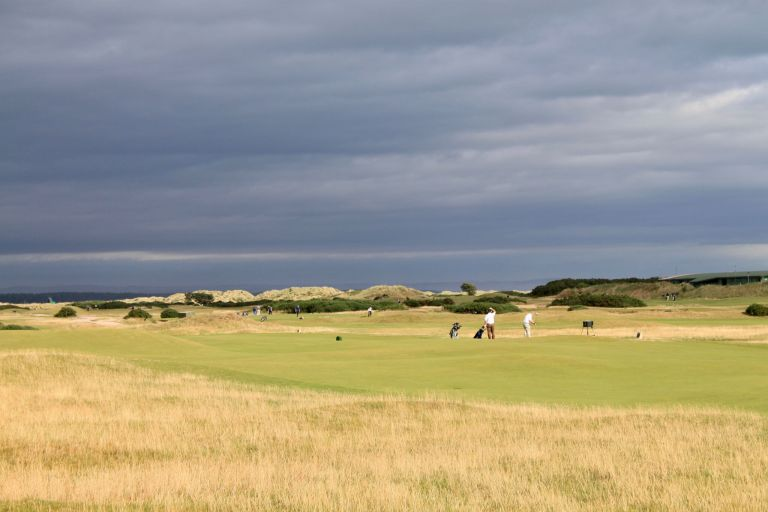 Golfers playing at St. Andrews