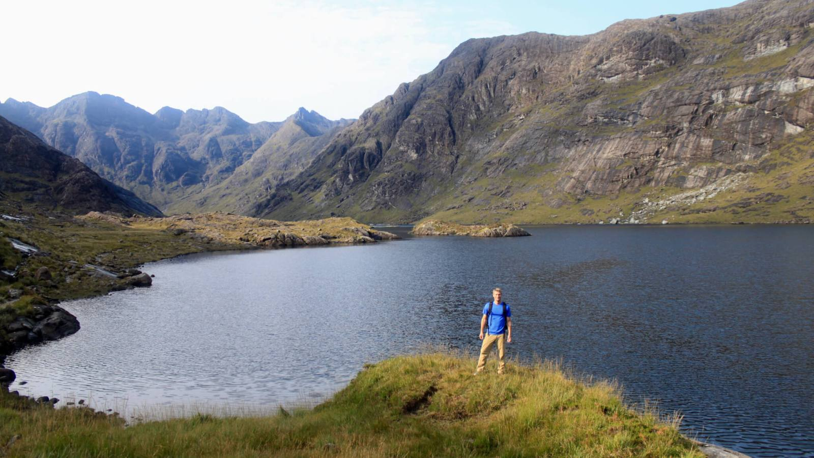 M standing in front of Loch Coruisk with mountains beyond