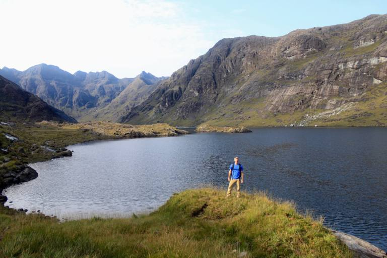 M standing in front of Loch Coruisk and the surrounding mountains
