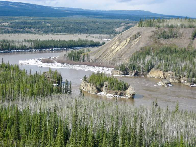 Five Finger Rapids in Yukon River with forests and mountains