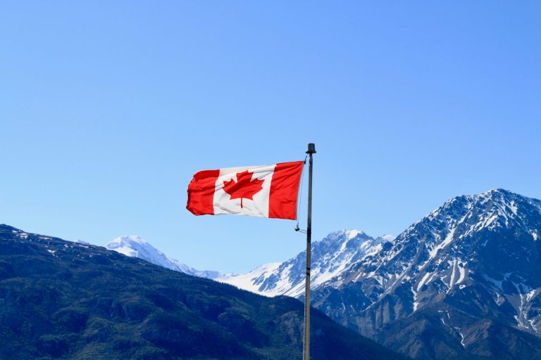 Canadian flag with mountains behind