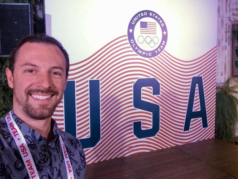 Max in front of a Team USA sign