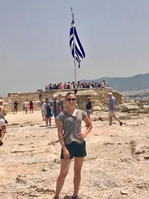 Ellen in front of Greek flag and Acropolis
