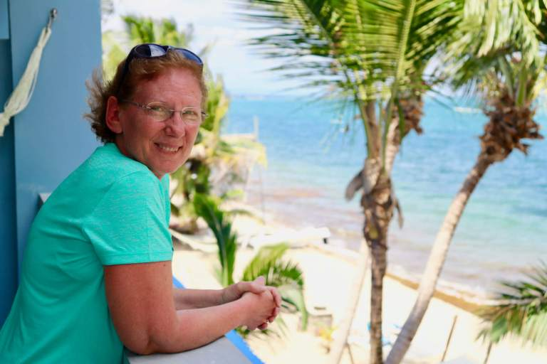 Mom enjoying the view from our balcony in Hopkins, Belize