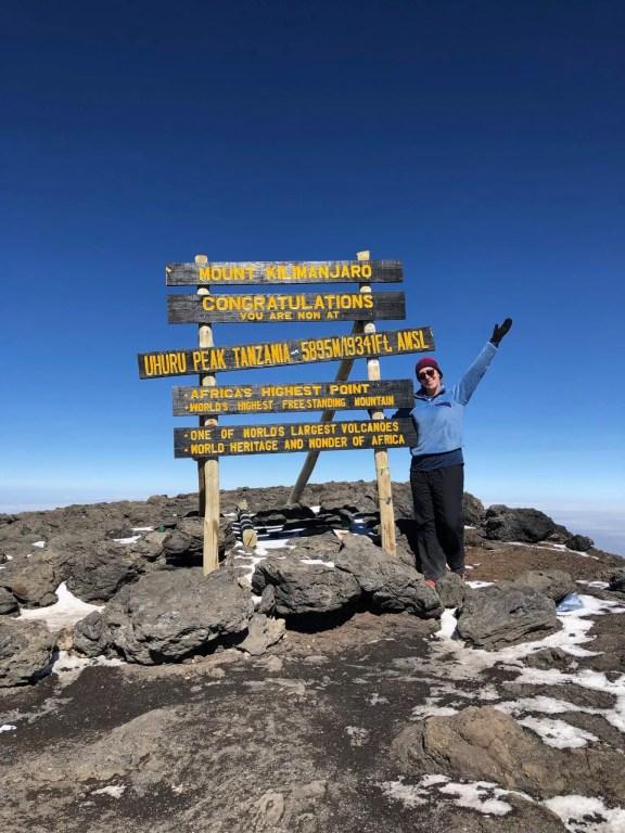 Michelle at the summit of Mt. Kilimanjaro in Tanzania