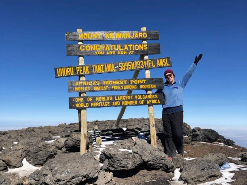 Michelle at the summit of Mt. Kilimanjaro in Tanzania