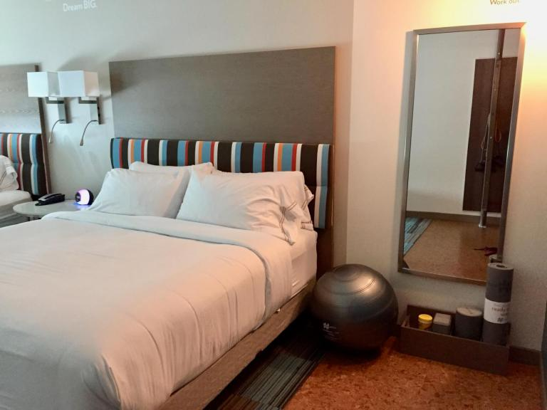 Exercise equipment next to hotel bed