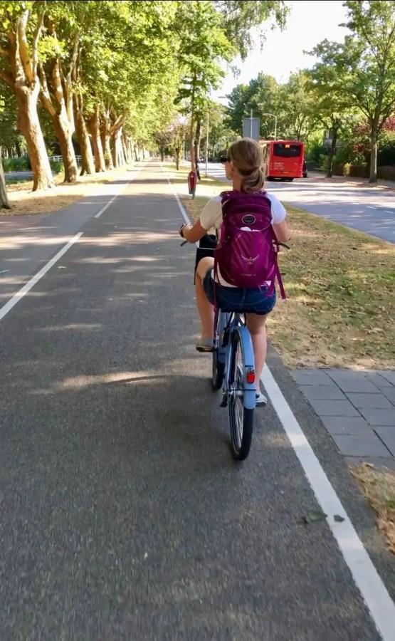 Gwen biking on bike path