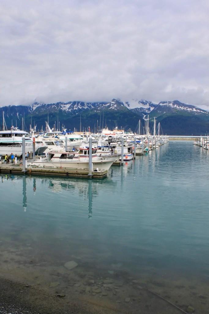 Boats in the marina in Seward, Alaska, with mountains behind
