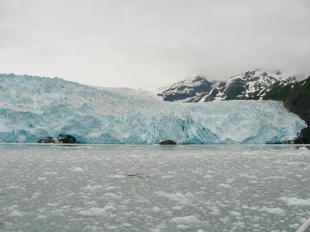 Huge blue glacier on a cloudy day