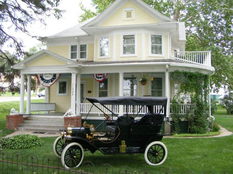 Oft's Bed and Breakfast with antique car in front