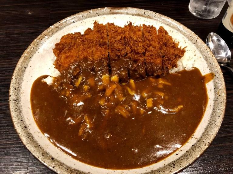 Crispy pork katsu with white rice and brown sauce