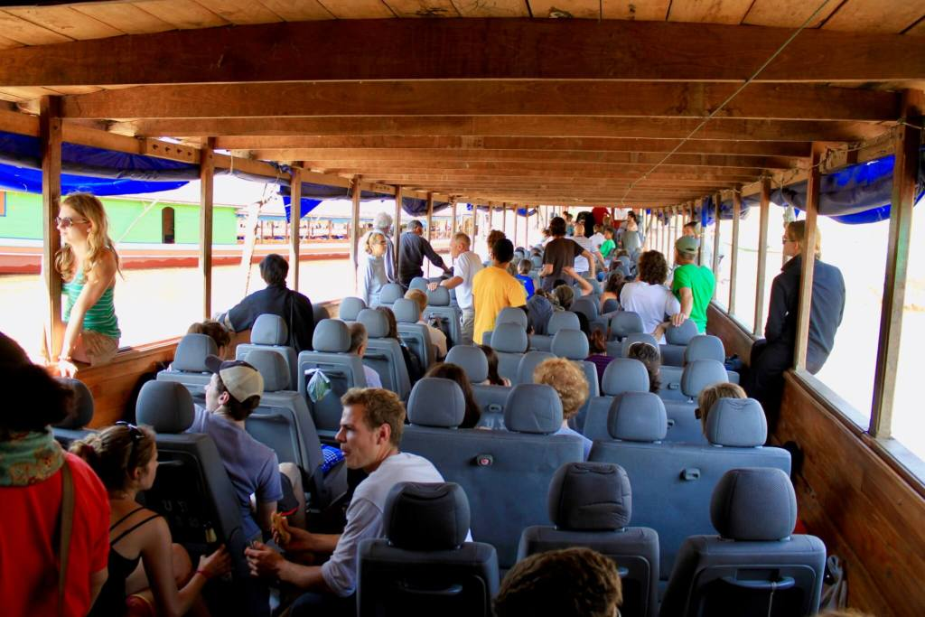 Interior of the longboat filled with people