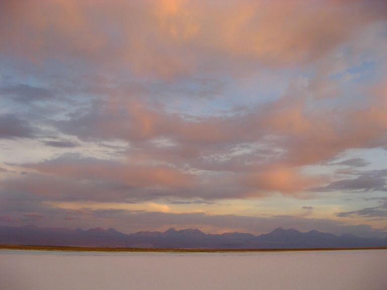 Pink clouds and pink-hued mountains