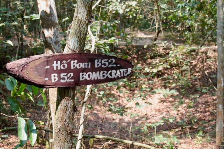 Sign pointing to a bomb crater from a B52 bomber