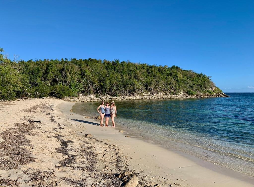 Gwen, Mom, and Brooke on the deserted beach where snorkeling took place