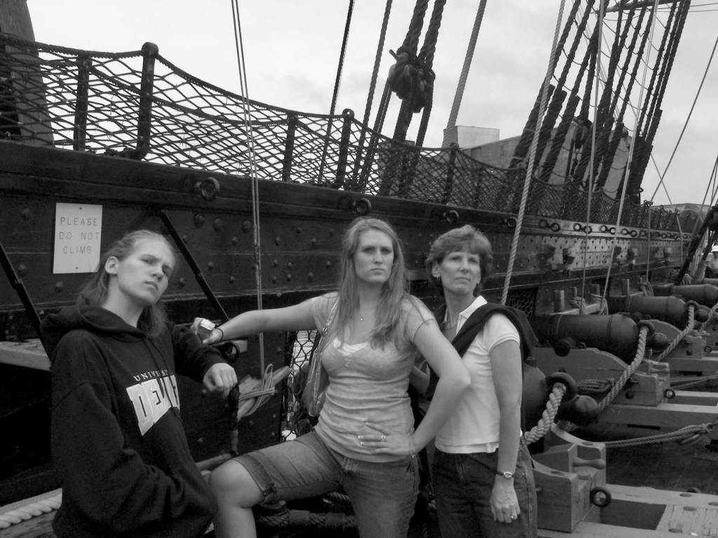 Gwen, her mom, and sister looking tough on the USS Constitution on a family vacation to Boston